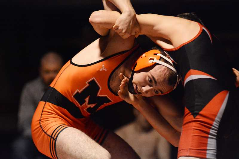 PMG PHOTO: DEREK WILEY - Molalla wrestler Colby Findley won by fall Tuesday night against Santiam Christian.