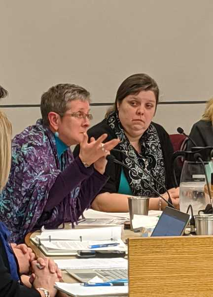 PMG PHOTO: COURTNEY VAUGHN - Portland School Board member Rita Moore chimes in during a board meeting Jan. 7. To the right, board member Eilidh Lowery listens.