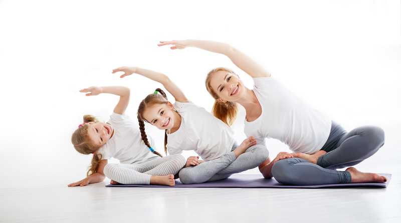 COUURTESY PHOTO  - You and your toddlers will enjoy taking yoga classes together. Sign up for Parent & Me Yoga offered through Lake Oswego Parks and Rec.