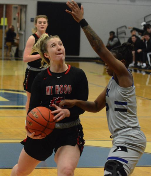 PMG PHOTO: DAVID BALL - Mt. Hoods Kelsey Higgins drives the lane during the first half. She finished with five points off the bench in the teams 53-37 win at Clark College on Wednesday.