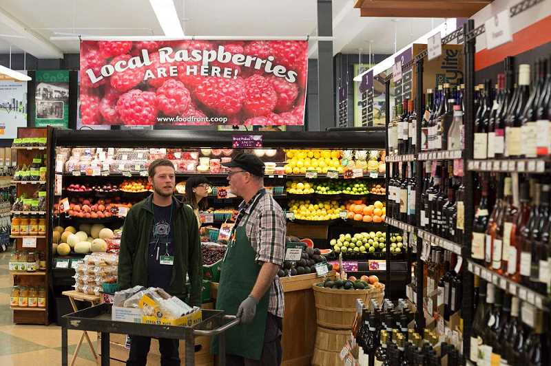 2015 - Food Front employees in front of the store's small-but-select wine section.
