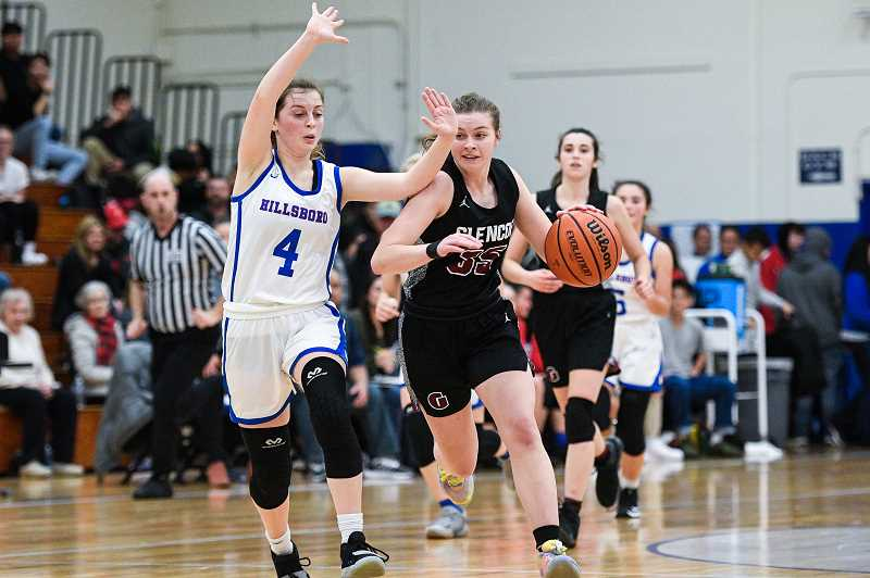 PMG PHOTO: CHRISTOPHER OERTELL - Glencoe's Mallory Confer dribbles up the court as Hillsboro's Margaret Shively defends during the Tide's game against the Spartans Wednesday night, Jan. 8, at Hillsboro High School.