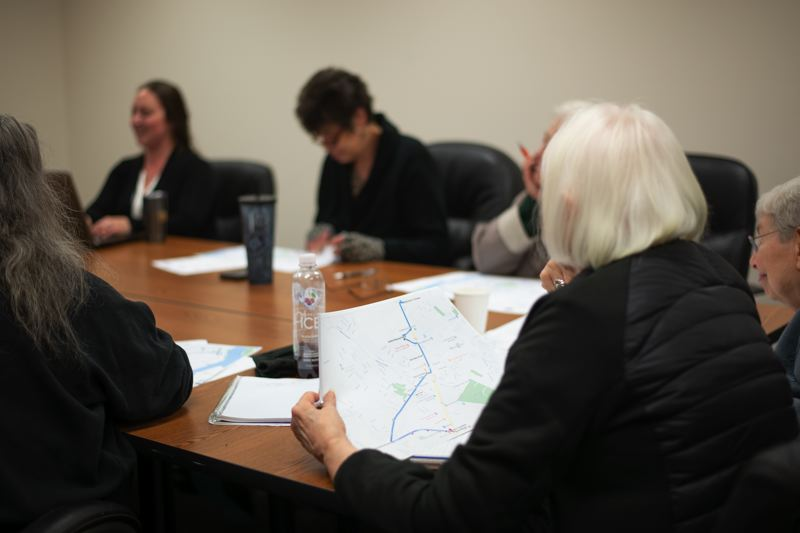 PMG PHOTO: ANNA DEL SAVIO - A member of the Columbia County Rider Transit Advisory Committee reviews potential route changes at a committee meeting in 2019.
