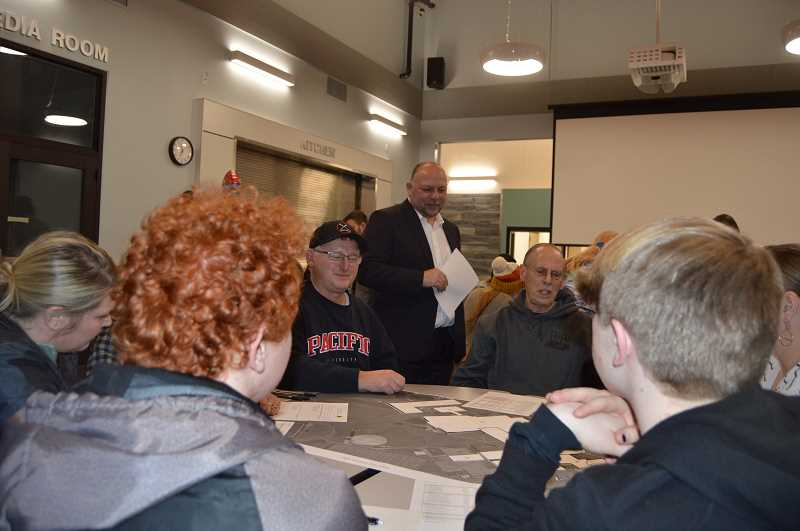 PMG PHOTO: MARK KIRCHMEIER - Roughly 25 people attended a St. Helens School Board work session Wednesday, Jan. 8, that included a presentation about options for remodeling the St. Helens High School. The district is pursuing a $63 million bond to effectuate the remodeling effort in the May primary election. Standing, St. Helens School District Superintendent Scot Stockwell meets with attendees.