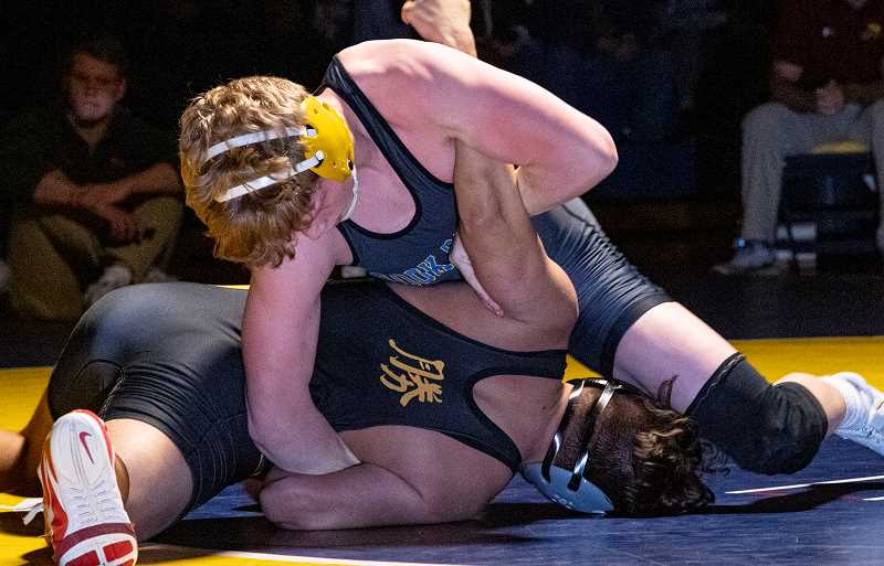 LON AUSTIN/CENTRAL OREGONIAN - Brayden Duke works to turn Redmond's Rylon Lynch to his back during their 152-pound match Wednesday night. Duke won by fall in the first round as the Cowboys went on to take a 53-21 win over the Panthers in the Intermountain Conference dual.