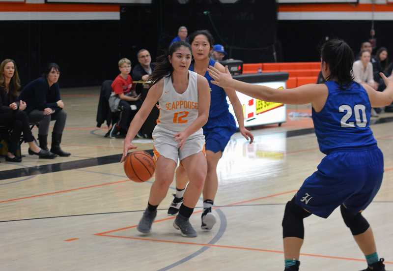 PMG FILE PHOTO - Senior Allison Wills is Scappooses team captain and a Pacific University womens basketball prospect. She posted a team high 10 points on a tough night in Silverton, more than half of the teams total points.