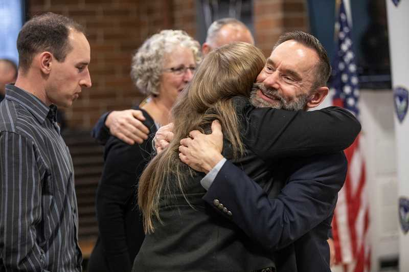 PMG PHOTO: JONATHAN HOUSE - Tigard Police Departments Jim Wolf hugs family members after giving a speech at his retirement party.