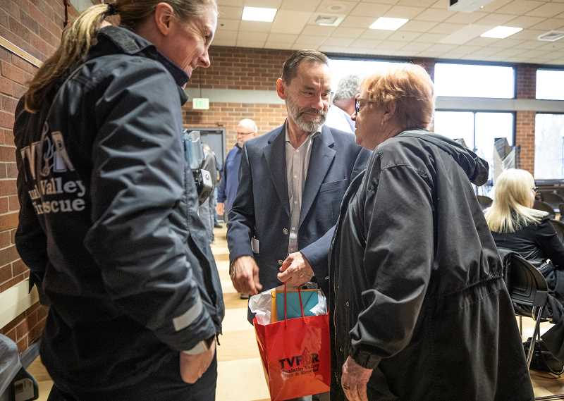 PMG PHOTO: JONATHAN HOUSE - Tigard Police Departments Jim Wolf chats with Oregon State Rep. Margaret Doherty at his retirement party.