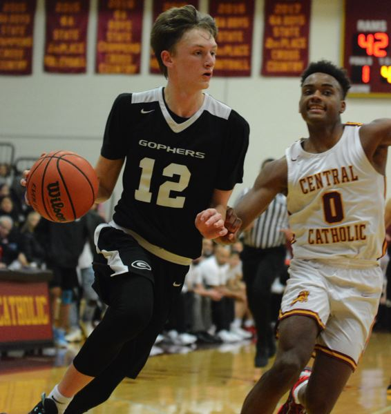 PMG PHOTO: DAVID BALL - Greshams Ethan Abrahamson takes the corner against Centrals DeRey Seamster during the Gophers 72-63 road win Thursday night.