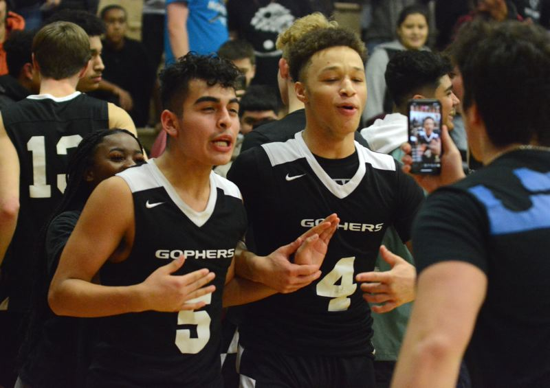 PMG PHOTO: DAVID BALL - Gresham teammates Nate Caro (5) and Jaylen Welch pose for a photo in the aftermath of Thursdays 72-63 win that snapped Centrals 16-game league winning streak.