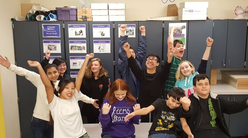 COURTESY PHOTO: CLEAR CREEK MIDDLE SCHOOL  - Students in Tom Erickson's science class celebrate their success in the Samsung Solve for Tomorrow invention contest.
