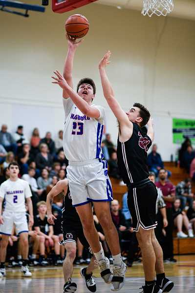 PMG PHOTO: CHRISTOPHER OERTELL - Hillsboro's Nate Smith goes up for a lay-in while Glencoe's Camren Womack defends during the Spartan and Tide's game Wednesday, Jan. 8, at Hillsboro High School.