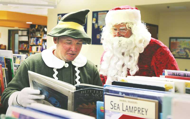 SUBMITTED PHOTO - Public works employees Brian Faulhaber (left) is the head elf while Leo French-Pinzon portrays Santa during the city's annual treelighting ceremony in December.