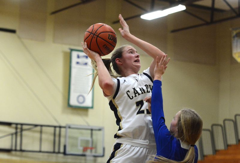 PMG PHOTO: DEREK WILEY - Canby senior Nicole Mickelson scored nine points Tuesday night at Sheldon.