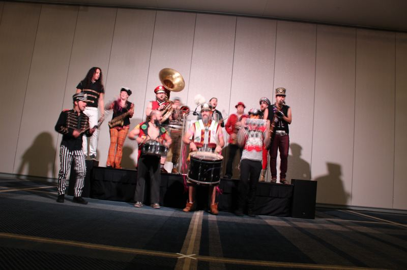 PMG: JOSEPH GALLIVAN - The March Fourth Marching Band was hired to play one song and lead guests into the ballroom to hear speeches. Bikers on tall bicycles with LED lights were also hired to bring some Portland flavor to the Hyatt and ride up and down outside the hotel.
