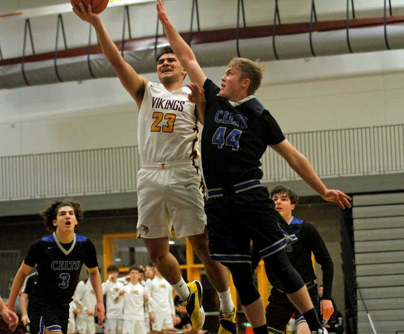 PMG PHOTO: WADE EVANSON - Forest Grove's Guy LIttlefield attacks the basket during the Vikings' game with the McNary Friday, Jan. 10, at Forest Grove High School.