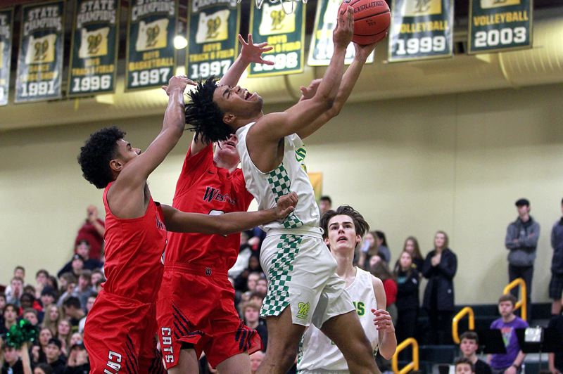 PMG PHOTO: MILES VANCE - West Linn senior guard Micah Garrett attacks the basket during the first half of his team's 56-47 win over Westview at West Linn High School on Friday, Jan. 10.