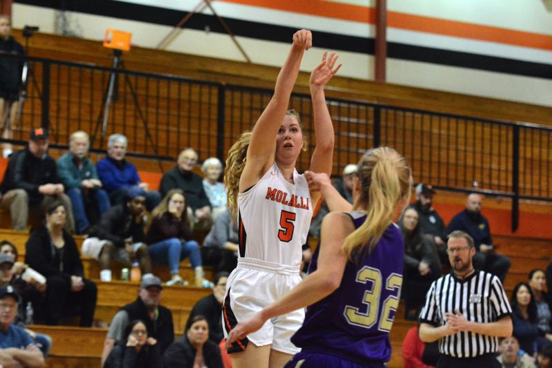PMG PHOTO: DEREK WILEY - Molalla sophomore Rubie Burge scored 13 points Friday against Astoria.