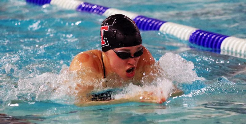 PMG PHOTO: DAN BROOD - Tualatin High School senior Britney Muralt is on her way to victory in the 100-yard breaststroke event during the Timberwolves' 87-83 league victory over St. Mary's.
