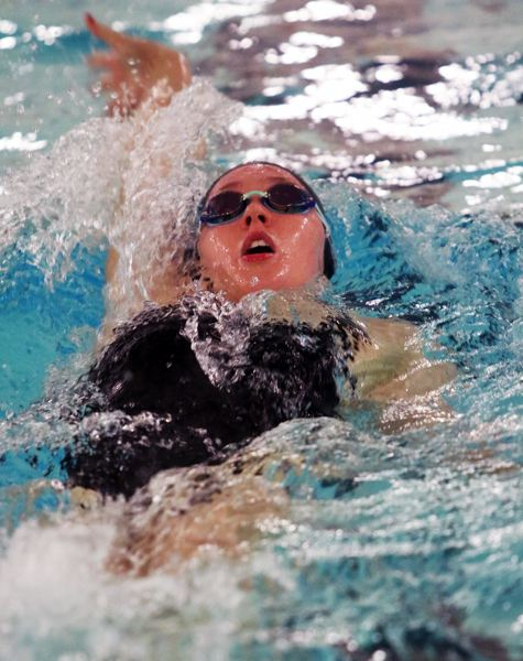 PMG PHOTO: DAN BROOD - Tualatin High School senior Abbi Karsseboom won the 100-yard backstroke event and the 200 freestyle during the Timberwolves league victory over St. Mary's.