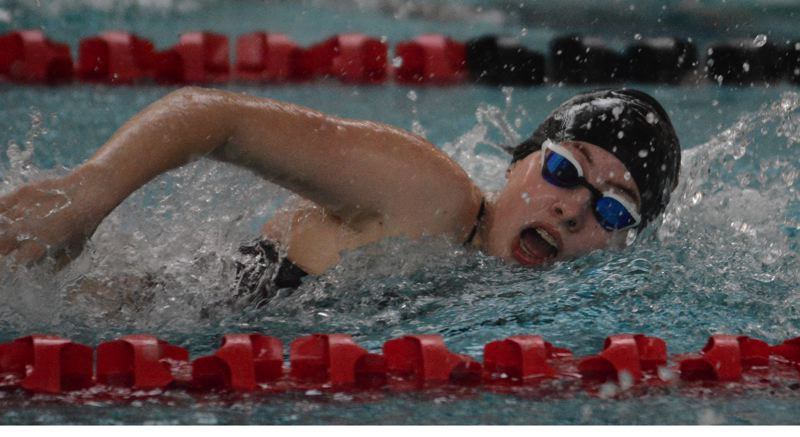 PMG PHOTO: DAVID BALL - Clackamas Isabelle Fleser powers through the water during her win in the 100-yard freestyle Thursday at David Douglas.