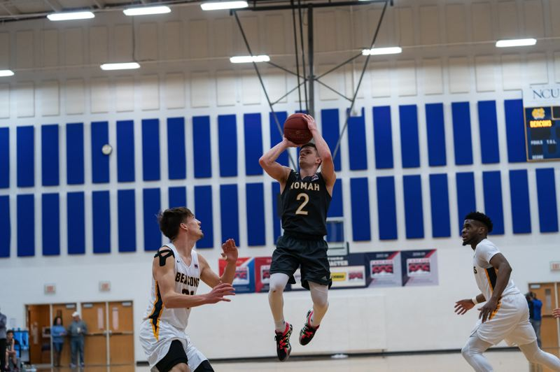 COURTESY PHOTO: NORTHWEST CHRISTIAN ATHLETICS - Multnomah Lions guard Justin Martin goes up for a shot against Northwest Christian on his way to scoring an NAIA Division II-record 74 points.
