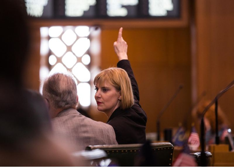 BRADLEY W. PARKS/OPB - Former state Rep. Jennifer Williamson in the Oregon House chambers.