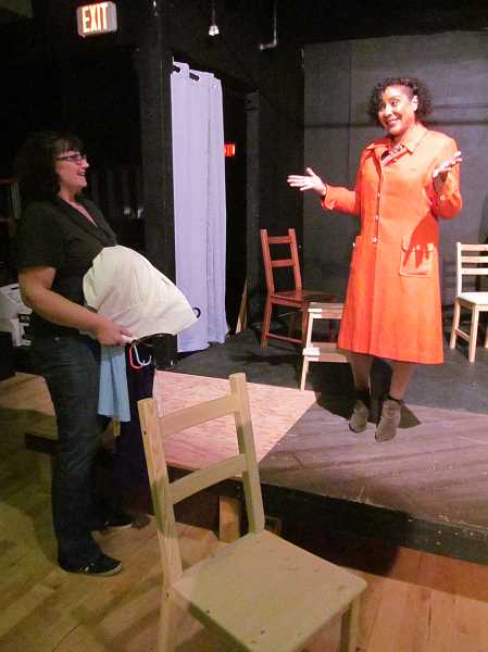 PHOTO BY DICK TRTEK -  Amber Black, left, the costumer for 'Blind,' likes the look of Andrea White's orange '60s era coat.