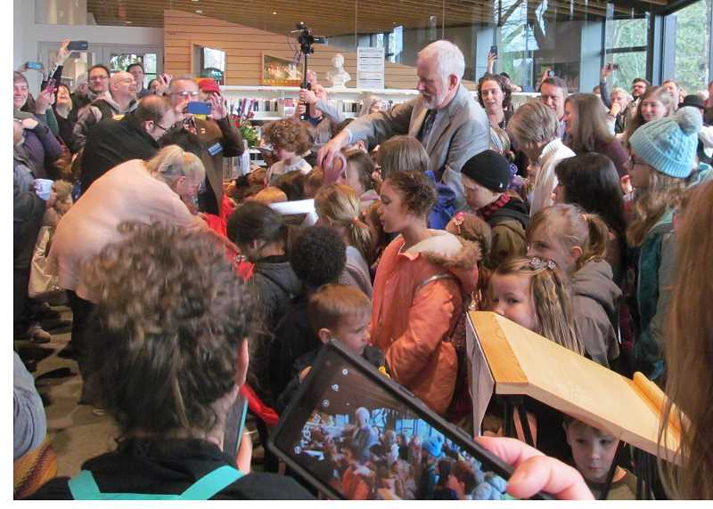 PHOTO BY DICK TRTEK - Surrounded by a crowd of children and community members, Mayor Mark Gamba prepares to cut the ribbon, officially opening the new Ledding Library in downtown Milwaukie.