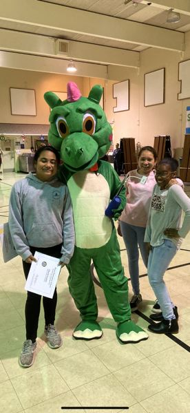 COURTESY PHOTO: DAVIS ELEMENTARY SCHOOL - Some Davis Dragons pose with their mascot (secret: its really Mrs. Furlong inside that suit).