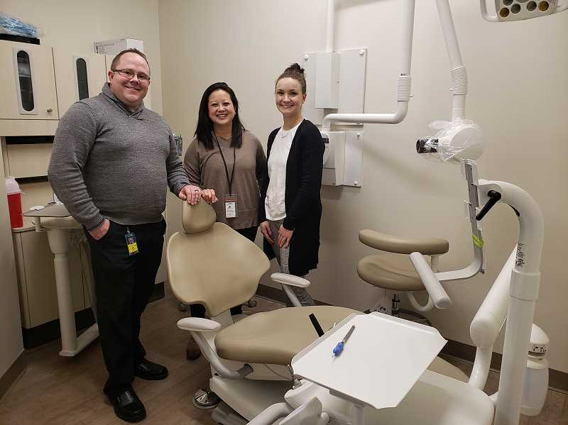 COURTESY PHOTO: GLADSTONE SCHOOL DISTRICT - In January 2020, Operations Manager Kyle Johnstone, Dental Director Selynn Edwards and Dental Navigator Abigail Garrett showed off one of three exam rooms at the new Gladstone Dental Clinic.