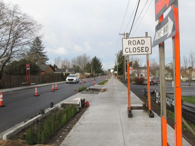 PMG PHOTO: SHANNON O. WELLS - Arata Road in Wood Village, which parallels the busy Northeast Halsey Street, has undergone a major upgrade project in the past several months, including widened sidewalks with eco-friendly bioswales and features to enhance both pedestrian and vehicular safety.