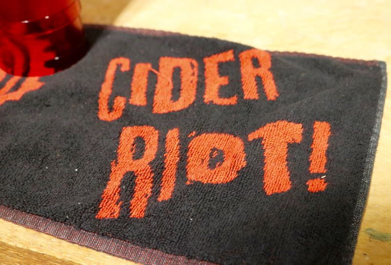 PMG PHOTO: ZANE SPARLING - A mat with the logo for defunct Portland bar Cider Riot! is shown here.