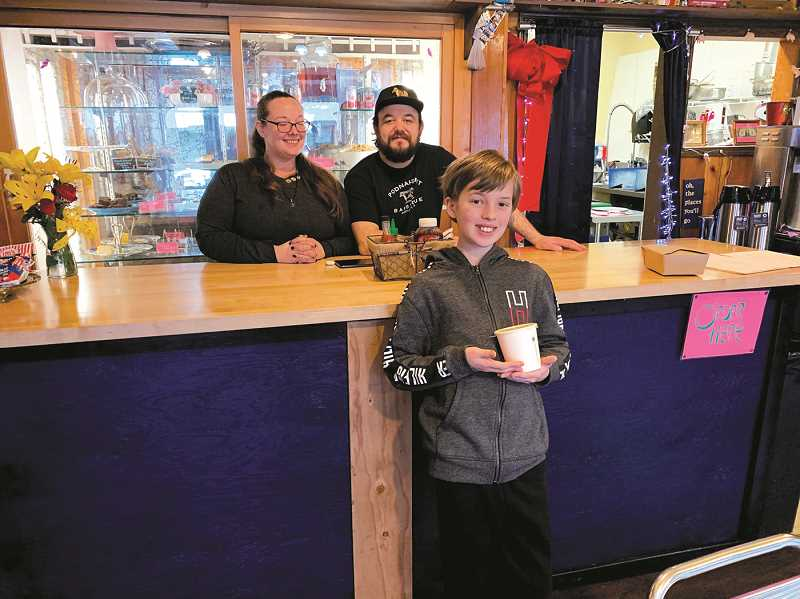 PMG PHOTO: CAROL ROSEN - Sarah Shanky, left, and Joe Selinger wait on 12-year old Brody Draper, who came in to get some Tuscan Soup for dinner. Brody goes to the Molalla River Academy.