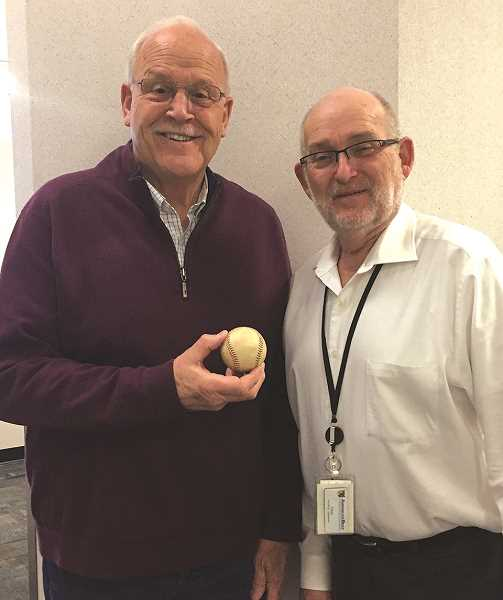 COURTESY PHOTO: GARY MILLER - Gary Miller (left) passes along a little bit of Lien family history to David Lien - a baseball signed by Canby native Alfred Lien, who played for the San Francisco Seals.