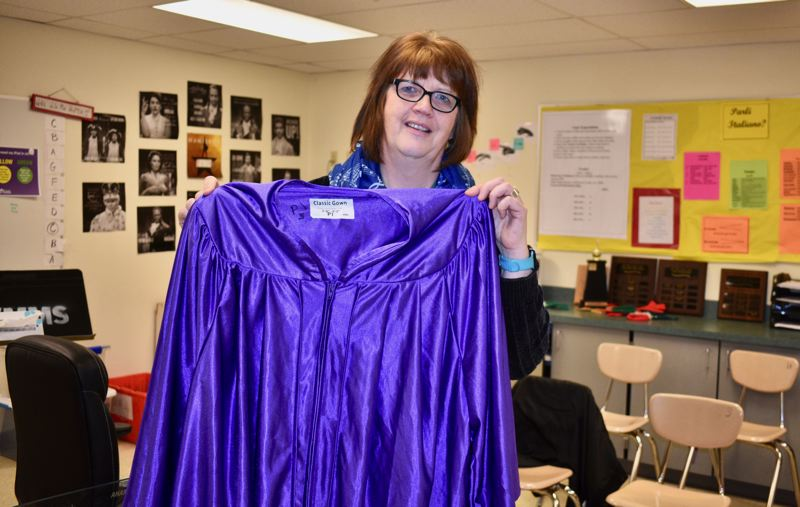PMG PHOTO: TERESA CARSON - Suzanne Chimenti, choir teacher at Walt Morey Middle School, shows off one of the new choir robes.
