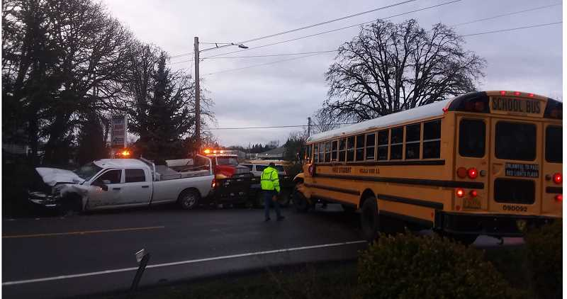 SANDY STOREY - Police and emergency personnel work through the accident that occurred Tuesday, Jan. 14, around 7 a.m. in Molalla.