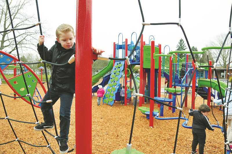 GRAPHIC PHOTO: GARY ALLEN - A youngster takes advantage of the new playground equipment at Edwards Elementary School last week.