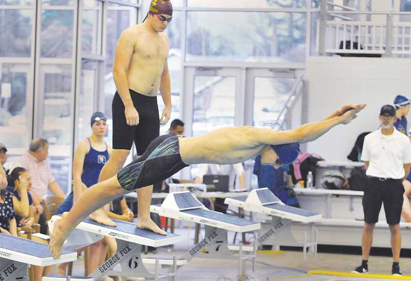 GRAPHIC PHOTO: GARY ALLEN - Both the boys and girls swim teams at Newberg High School are young and learning under the guidance of new coach Cari Blanchard, who also coaches the girls water polo team at the school.