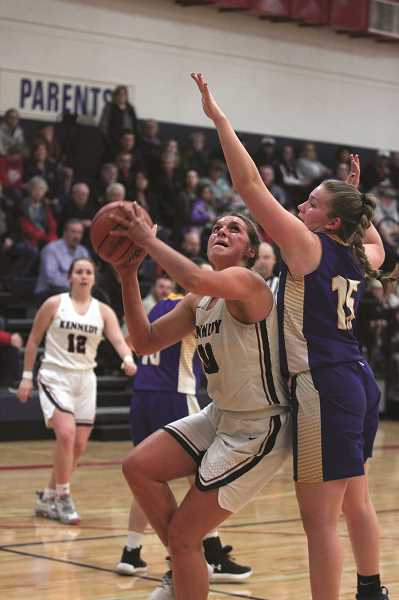 PMG PHOTO: PHIL HAWKINS - Kennedy senior Sophia Carley led all scorers with 18 points, going to the free throw line 13 times in the Trojans win over Gervais.
