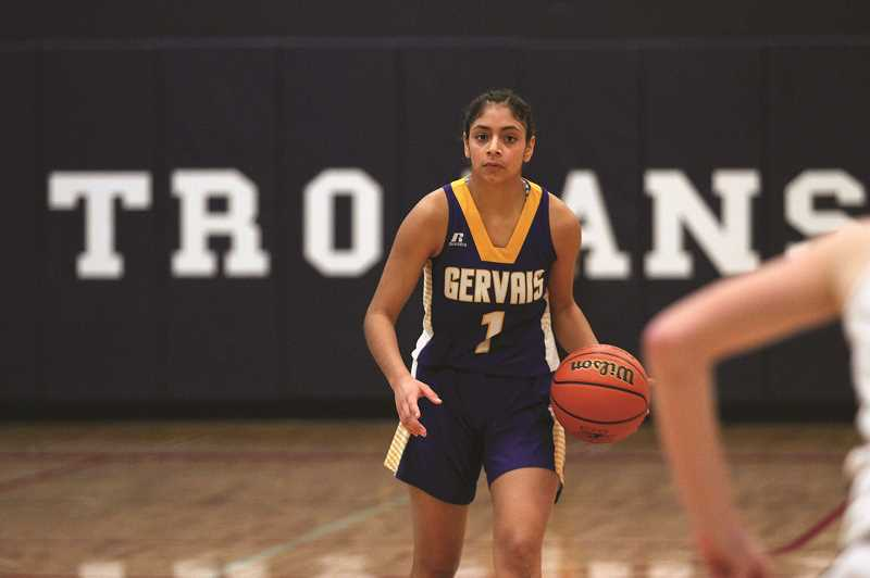 PMG PHOTO: PHIL HAWKINS - Gervais junior Araceli Vasquez led the Cougars with eight points, but was held relatively quiet after opening the game with a 3-pointer on her teams first possession.