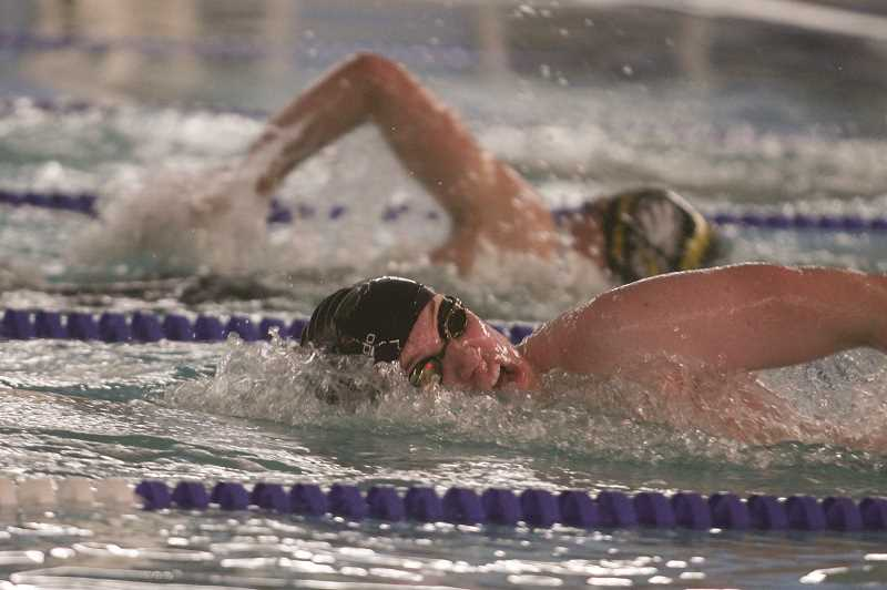 PMG PHOTO: PHIL HAWKINS - Kennedy senior Lucas Miller placed first in all four events in which he competed, taking the top spots in the 200 and 500-yard freestyle, while helping the 200 medley and 200 freestyle relay teams take first place as well.