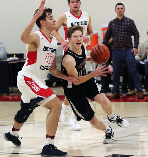 PMG PHOTO: DAN BROOD - Horizon Christian senior Cade Tillema (right) tries to drive to the basket against Westside Christian senior D.L. Scales during Saturday's league game.