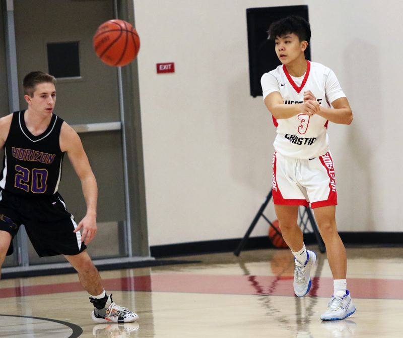 PMG PHOTO: DAN BROOD - Westside Christian High School junior Luke Jun (right) fires a pass during the Eagles' 60-32 win over Horizon Christian in Saturday's Lewis & Clark League game.