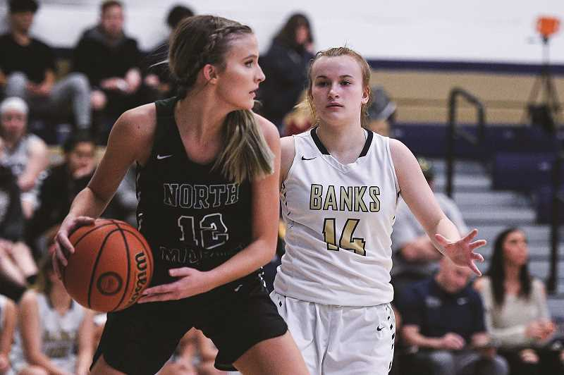 PMG PHOTO: CHRISTOPHER OERTELL - North Marion senior Katie Ensign led the Huskies with a game-high 13 points and 10 rebounds in a 37-18 win at Banks, including a 3-pointer to open the fourth quarter that started an eight-point run to put the contest out of reach.