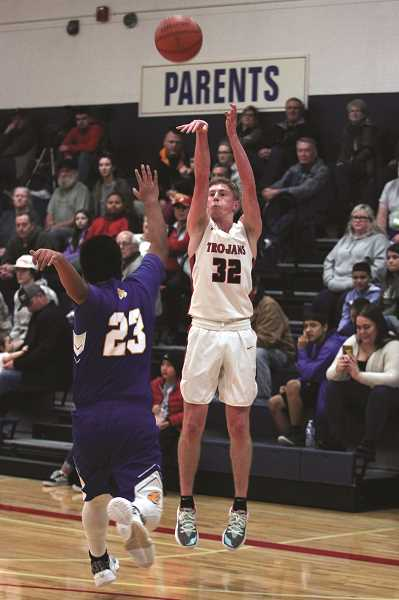 PMG PHOTO: PHIL HAWKINS - Kennedy senior Luke Hall dropped 25 points each in the Trojans 72-41 win against Gervais and 51-47 loss against Santiam last week.