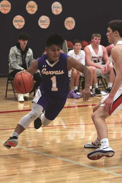 PMG PHOTO: PHIL HAWKINS - Gervais senior Daniel Hernandez led the Cougars with 14 points against the Trojans.