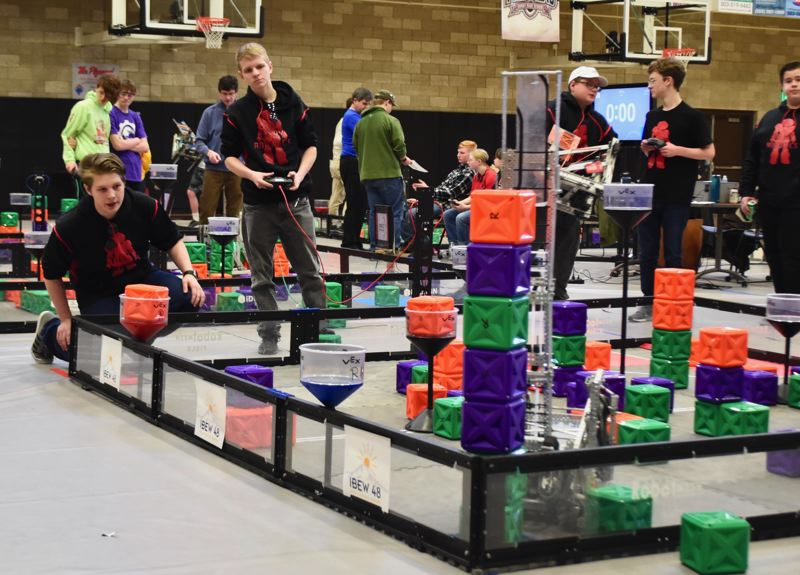PMG PHOTO: BRITTANY ALLEN - Sandy High School juniors Orion Skinner and Chase Richards take on skills challenge at VEX robotics tournament on Saturday, Jan. 11.