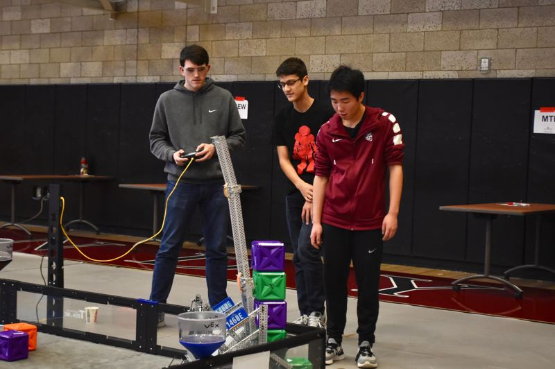 PMG PHOTO: BRITTANY ALLEN - Sandy High team Jordan Cotton, Andrew Hokanson and Nicky Chan compete at VEX robotics tournament on Saturday, Jan. 11.