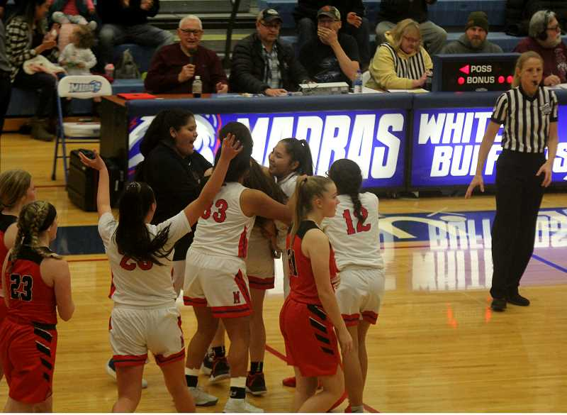 STEELE HAUGEN - The team celebrates with Smith-Francis after she hits the game winner.
